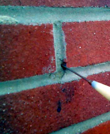 Injecting brick joint with 2mm needle