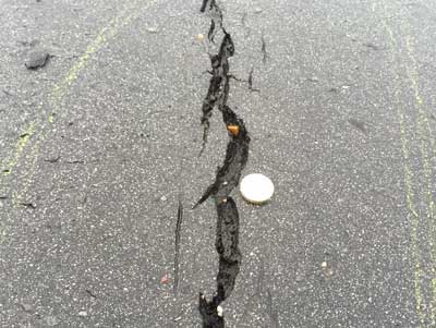 Cracks in asphalt and tarmac can be filled using Structural epoxy Pouring Grout