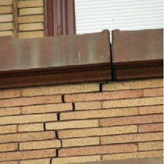 Stepped crack in a parapet wall, caused by movement lower down.