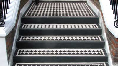 Tiled steps - can be tiled over a thin screed bonded to asphalt.